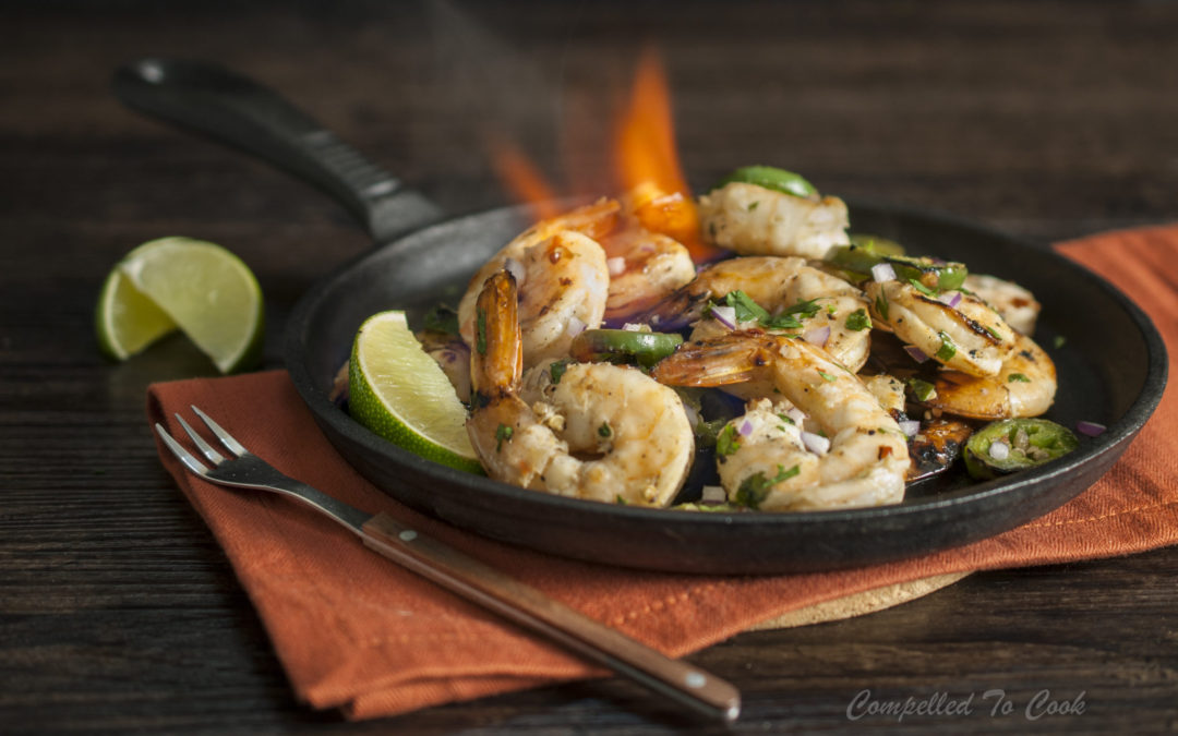 Spicy Grilled Vodka Shrimp are infused with lime and garlic then slightly charred and flambéed with chili vodka.