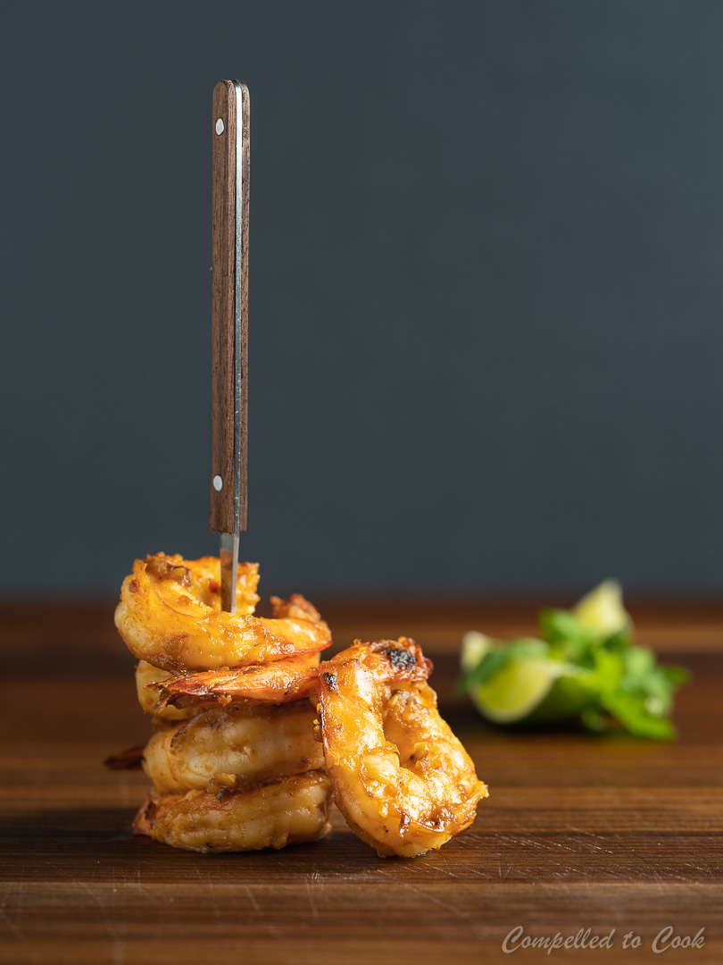 Spicy Miso Shrimp stacked high and skewered by a seafood fork.