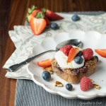A square of Baked Berry and Coconut Oatmeal topped with fresh berries and yogurt.