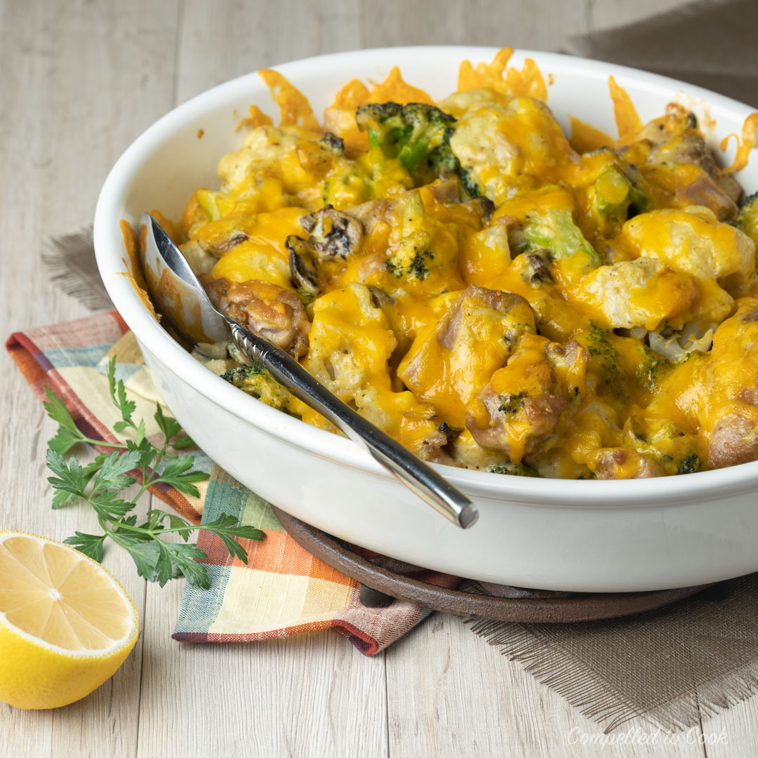 Cheesy Chicken Vegetable Casserole in an off white oval casserole dish ready to be served.
