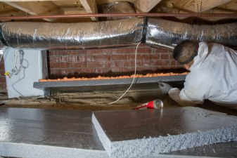 Insulation panel installed in crawl space