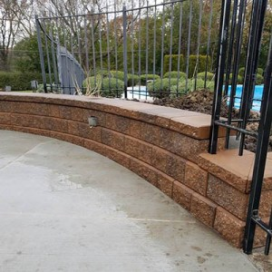brick paver sitting wall with electrical outlet