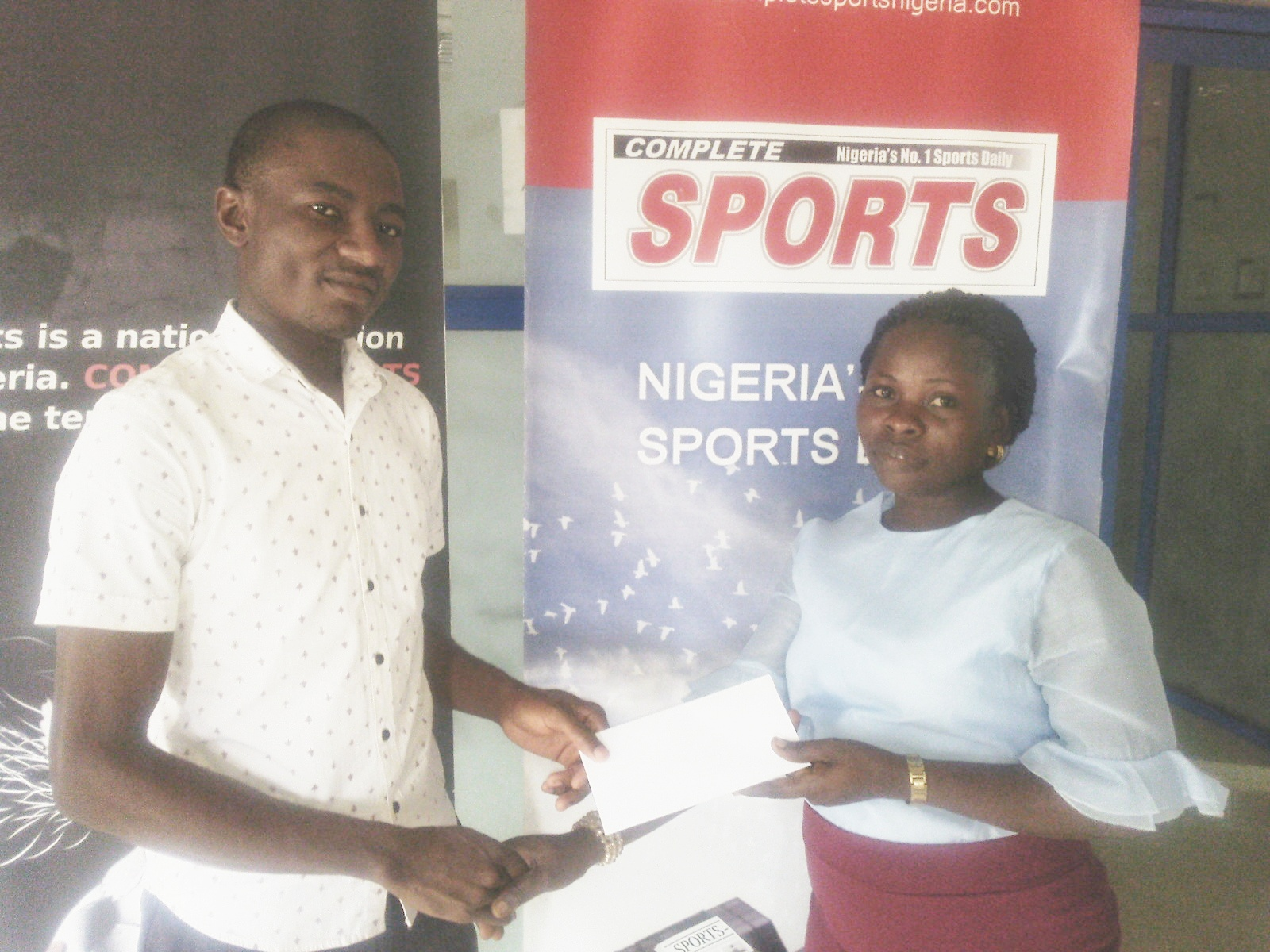 Winner Collects Cash Prize In Complete Sports' Predict And Win Competition
