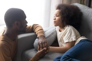 Father talking to child about mental health