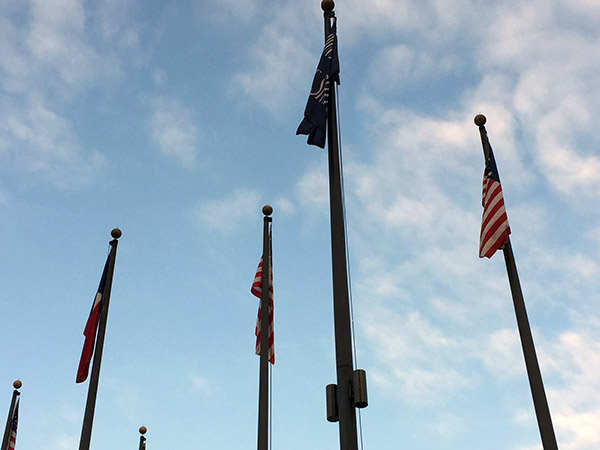 US Flags from history against the sky