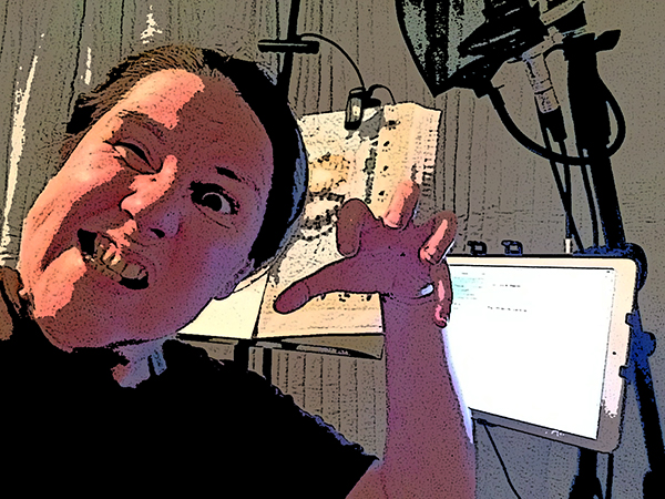 Laurie making a scary face in her sound studio and holding her hand like a claw!