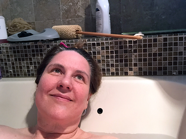 Laurie looking dreamy in a bathtub