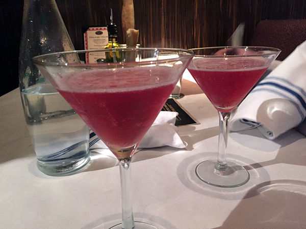 Bright pink drinks in martini glasses