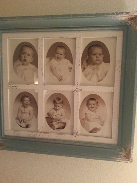 6 photos of baby Laurie in a turquoise frame.