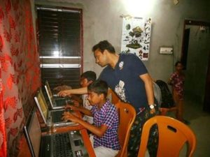 Students in Bangladesh working on computers donated by Computaris