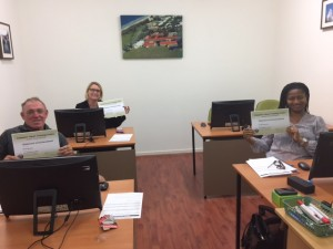 Happy clients have just completed 21 hours of training. They know their computers and software now.