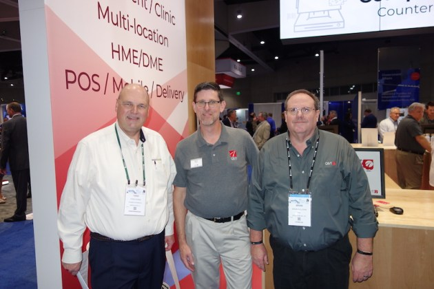 National Community Pharmacists Association 2019 Conference and Trade Show Exhibits From left, Todd Evers, from Dauber Pharmacy, with QS/1's Rich Muller and Brian Sullivan.