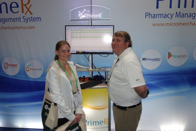National Community Pharmacists Association 2019 Conference and Trade Show Exhibits Karen Slagle from Northside Pharmacy with Micro Merchant Systems' Brent Patton.