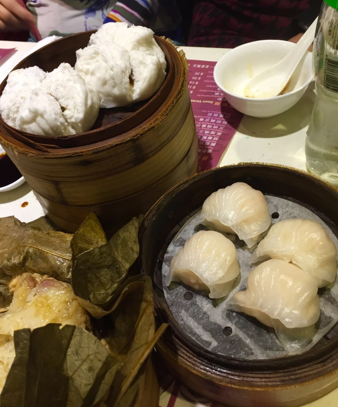 BBQ pork buns, shrimp dumplings, and lotus-wrapped sticky rice with different kinds of meat inside.