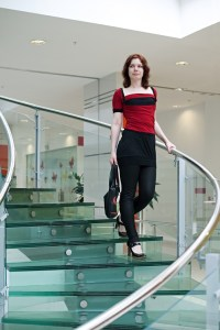 beauty woman on glass stair in modern interior