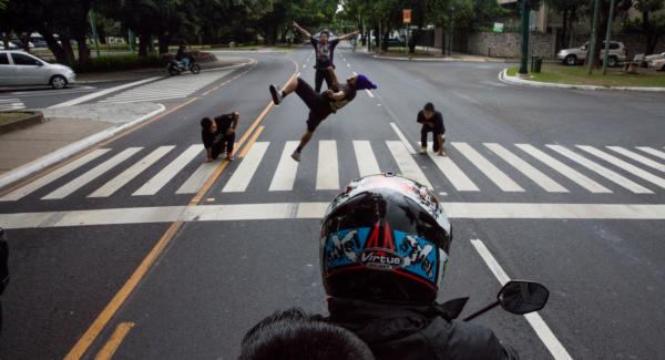 Break-Boys dancing at a traffic light in Guatemala City. Without music, the dancers count beats in their heads while performing.  Photo: Hyungsup Kim/Comvite