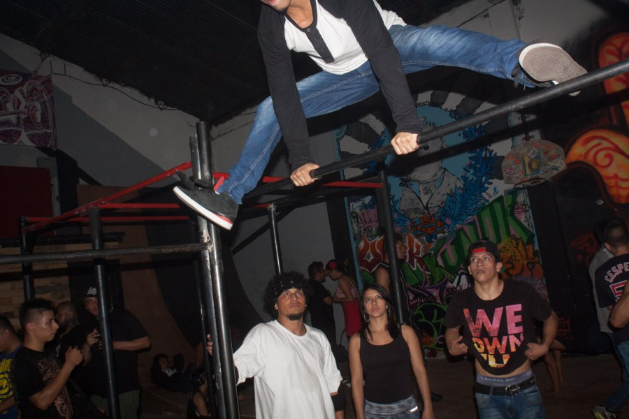 A dancer moves close to the ground in a party in Guatemala city: Photo: Hyungsup Kim/Comvite