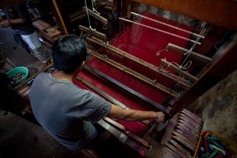 Textile being woven in a medieval foot pedal loom in Santiago Atitlán. Photo: Jeff Abbot/comvite