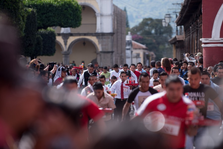 The mens division during the race takes off in La Antigua Guatemala. Photo: Santiago Billy/Comvite