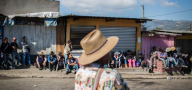 Protesters line the road leading to and out of the Los Encuentros crossroad, along the Pan-American highway, guarding against any incoming traffic and transport.