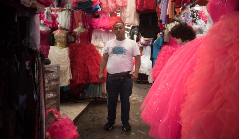 "Alex Pastor has been working for the last 15 years as a seller in this ""Quinceañera store"""
