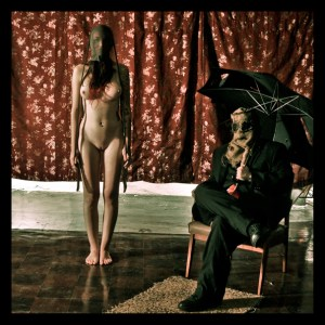 gothic image with nude model and scarecrow