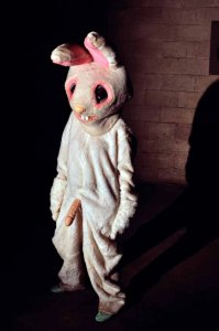 model in bunny suit wearing a strap on.