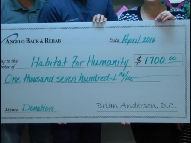 Habitat Presented Check from Doctor With a Heart_69388476-159532