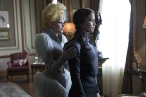 Katniss Everdeen (Jennifer Lawrence) prepares to take on the Capitol, with Effie Trinket (Elizabeth Banks) by her side.