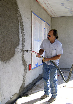 The Team At Tajmawall Applies Shotcrete And Pressure Molds To The Exterior Of A House