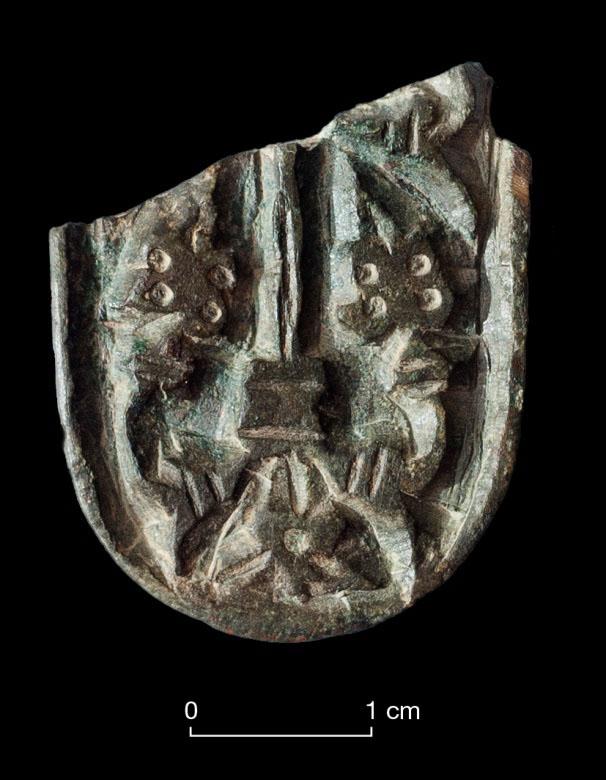 Adorno de cinturón de la Alta Edad Media en la cueva cántabra del Aspio