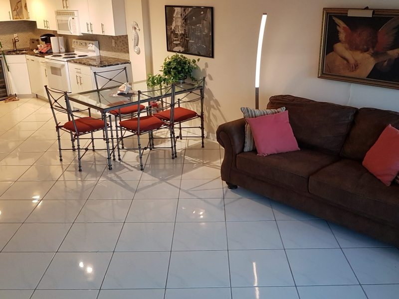 Queen sofa-bed, dining table and kitchen