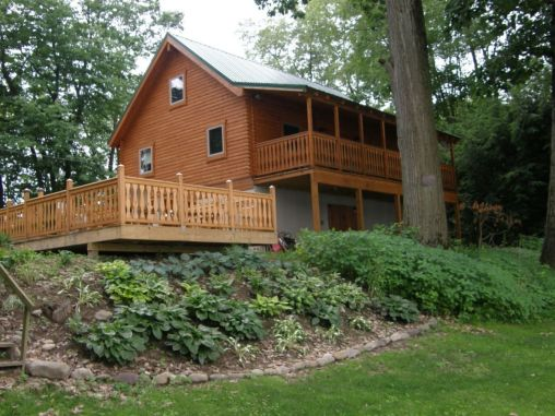 Log house with porch and large deck