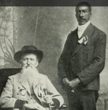 "Rev. Averitt (seated) and John Jackson (""Black Hawk"") standing"