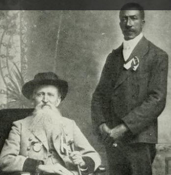 "Rev. Averitt (seated) and John Jackson (""Black Hawk"") standing"