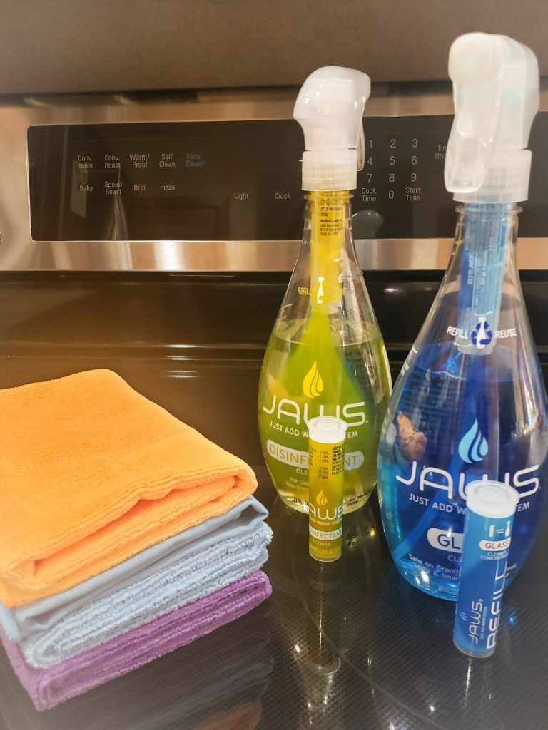 JAWS Disinfectant and Glass Cleaner bottles with their refill pods and Microfiber Cloths