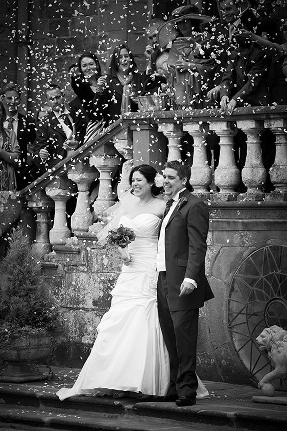 Confetti Moment - in the grand gardens of their venue using steps to arrange their guests