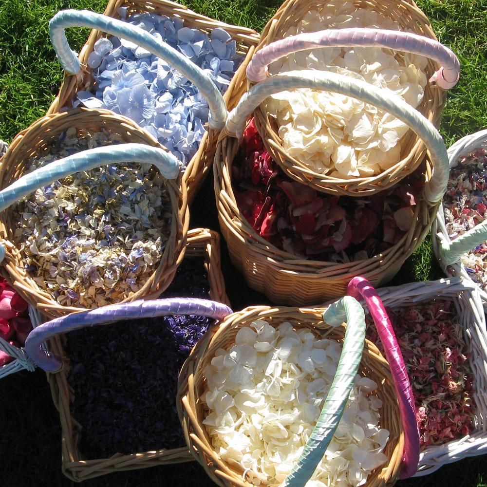 Flower girl baskets of real flower petal confetti