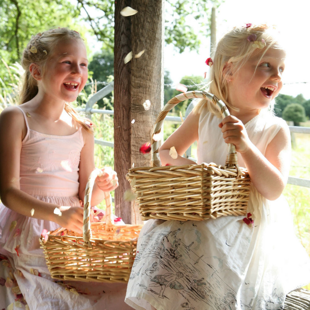 Flower girl baskets - flower girls enjoying the rose petals