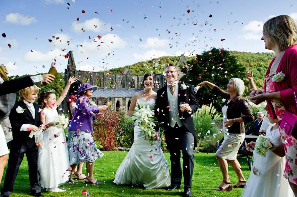 A Rainbow Rose Petal Confetti Moment with an amazing backdrop - Tintern Abbey