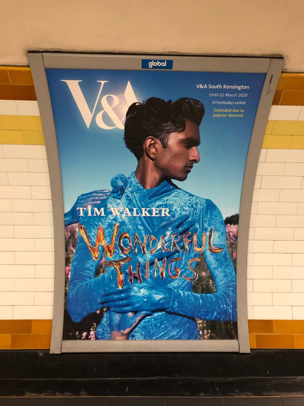 Advertising poster on the Tube for the Tim Walker Wonderful Things featuring The Confetti Flower Field