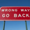 stock-photo-21439209-wrong-way-go-back-sign