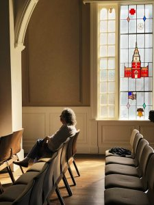 Woman sitting in an empty church