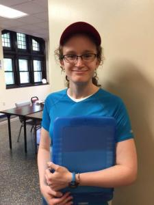 girl in blue shirt and cap - Quest Camp