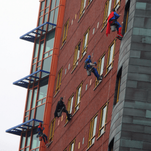 Spiderman, Batman, Captain America and Superman repel down the side of Children's Hospital of Pittsburgh of UPMC while washing windows on Wednesday - Photo Credit Nate Guidry/Post-Gazette