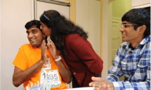 Chitra Sharathchandra gives a kiss to her son Tejus as his brother Akshay,17, looks on during the celebration of Tejus' 21st birthday at their home in Squirrel Hill. Post Gazette Photo Credit: Rebecca Droke