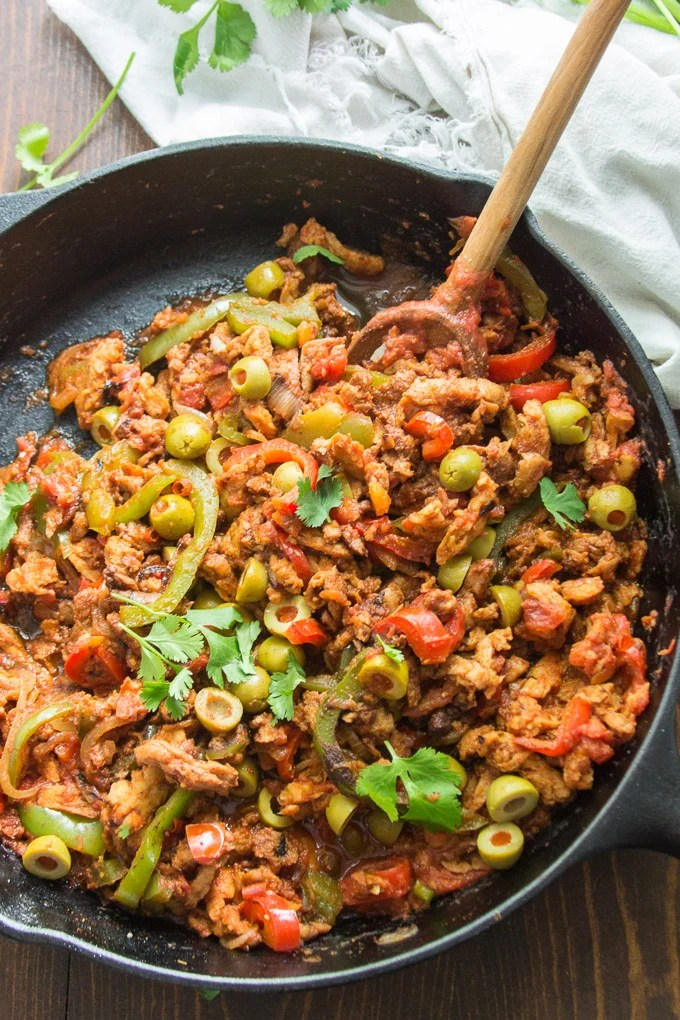 Vegan Ropa Vieja in a Cast Iron Skillet with Wooden Spoon