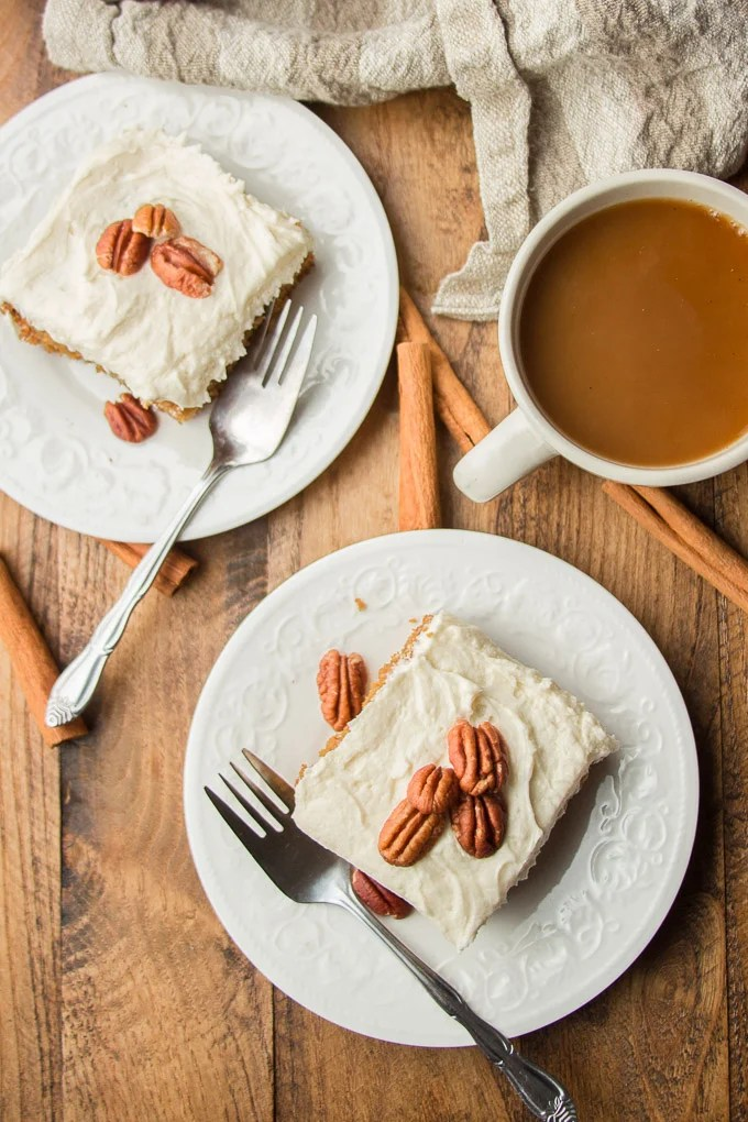 Overhead View of a Wooden Table with Coffee Cup, Forks, and Two Plates of Spice Cake