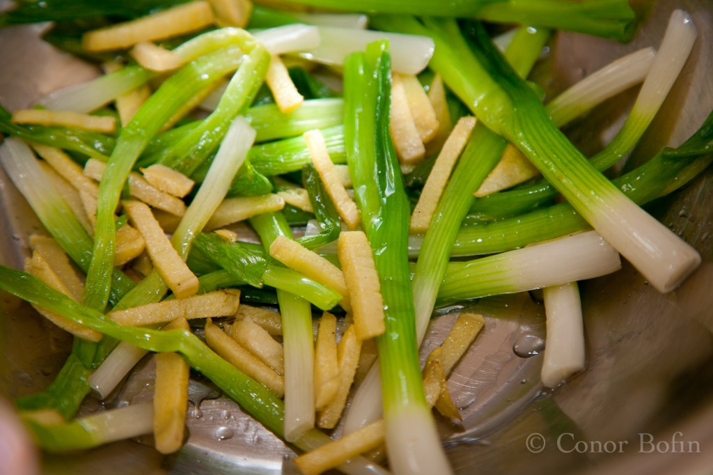Spring onions and ginger strips fried.