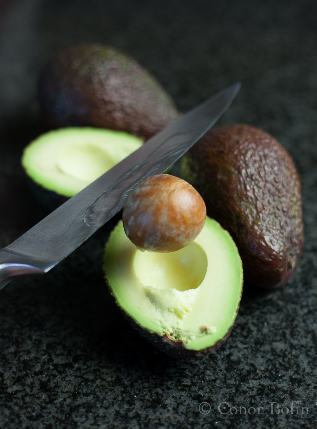 Extracting the nut from the avocado with a knife. Very satisfying.